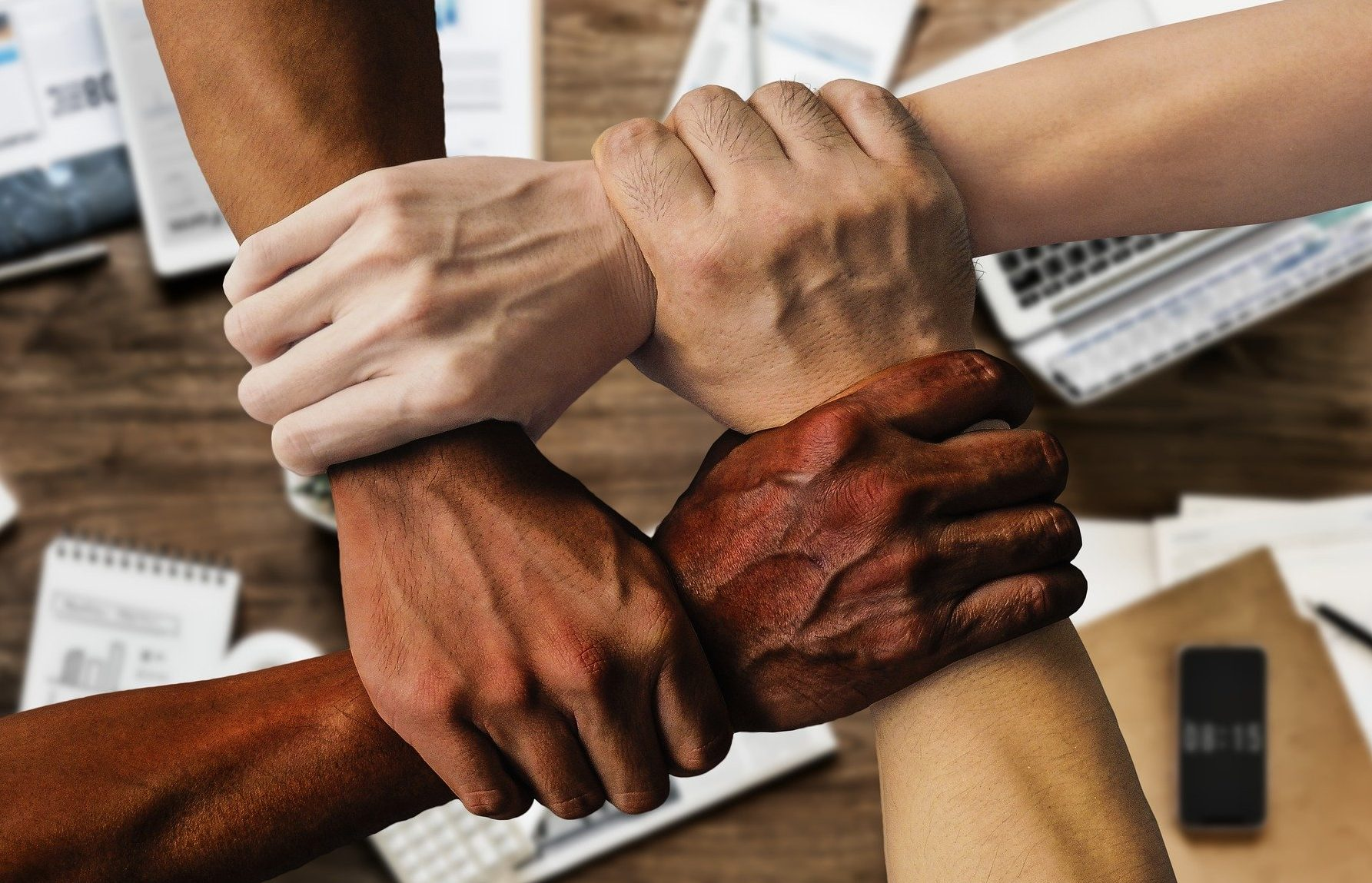 People of various racial background supporting each other.